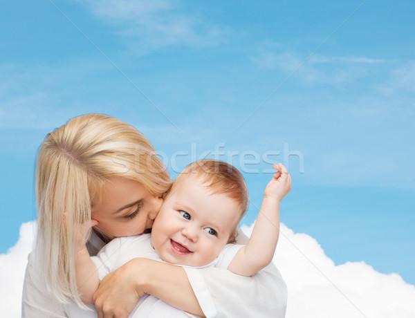 happy mother kissing smiling baby Stock photo © dolgachov