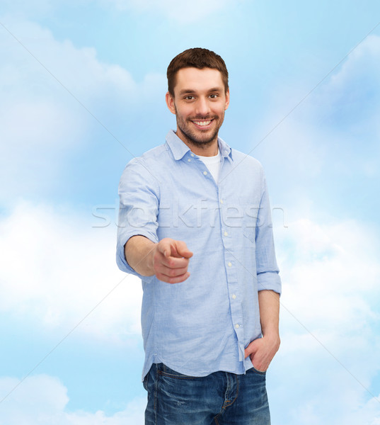 smiling man pointing finger at you Stock photo © dolgachov