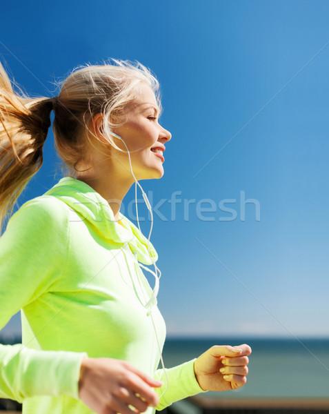 woman doing running outdoors Stock photo © dolgachov