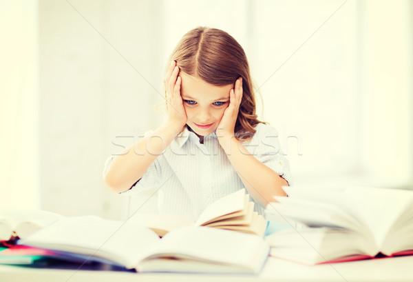 pretty girl with many books at school Stock photo © dolgachov
