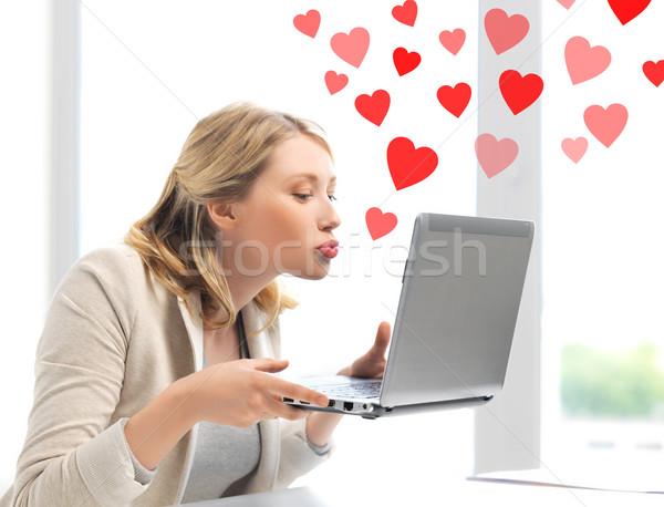 woman sending kisses with laptop computer Stock photo © dolgachov
