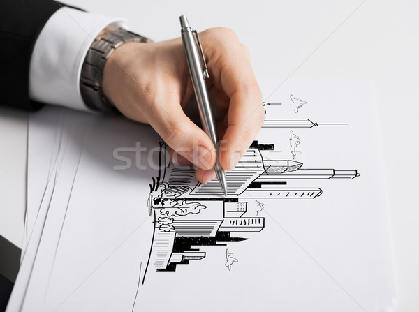 close up of male hand with pen drawing graph Stock photo © dolgachov