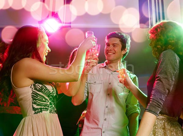 Mosolyog barátok szemüveg pezsgő klub buli Stock fotó © dolgachov