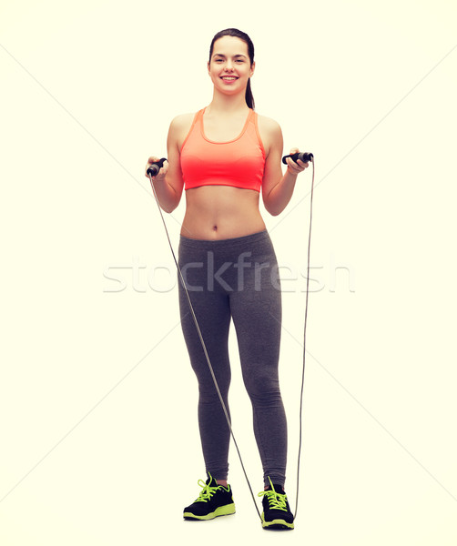 sporty woman with with skipping rope Stock photo © dolgachov