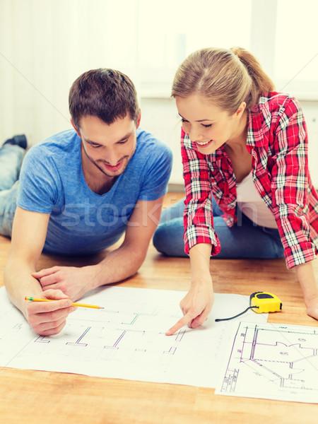 笑みを浮かべて カップル 見える 青写真 ホーム 修復 ストックフォト © dolgachov
