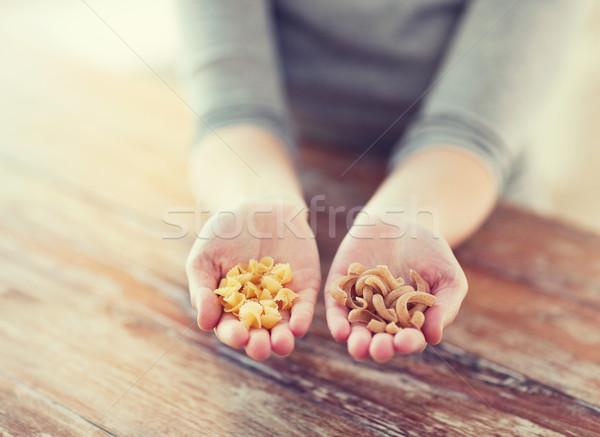 Kadın eller farklı makarna pişirme gıda Stok fotoğraf © dolgachov