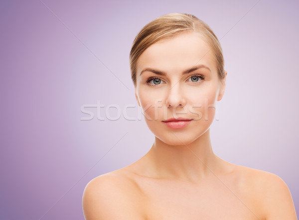 beautiful young woman with bare shoulders Stock photo © dolgachov