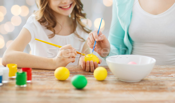 close up of family coloring easter eggs Stock photo © dolgachov