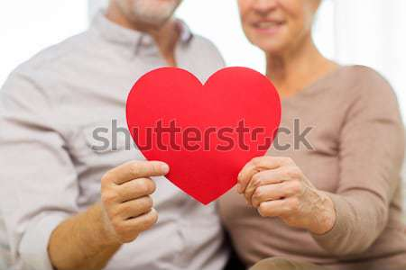 close up of happy lesbian couple with red hearts Stock photo © dolgachov