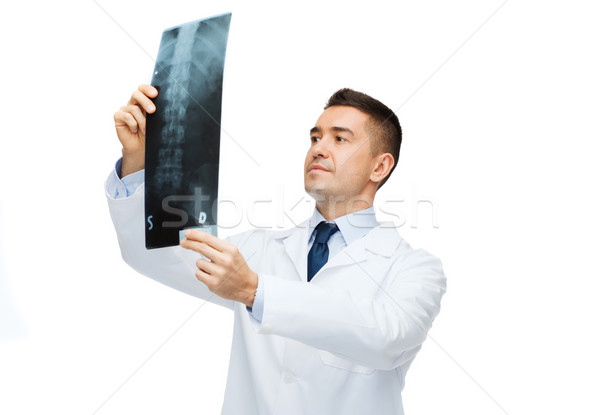 male doctor in white coat looking at x-ray Stock photo © dolgachov