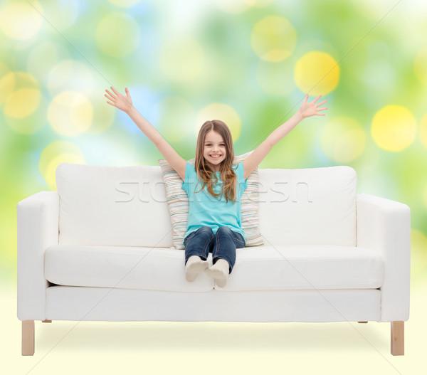 Menina feliz sessão sofá as mãos levantadas casa lazer Foto stock © dolgachov