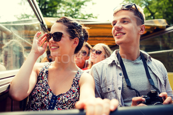 Stock photo: smiling couple with camera traveling by tour bus