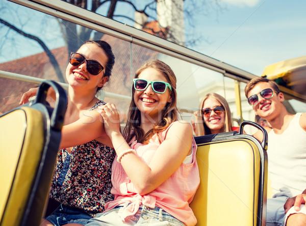 Csoport mosolyog barátok utazó turné busz Stock fotó © dolgachov