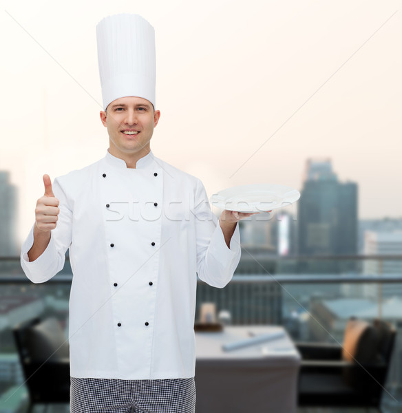 Gelukkig mannelijke chef kok tonen Stockfoto © dolgachov