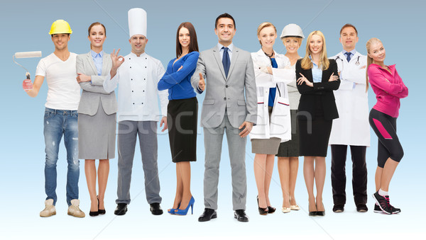 happy businessman over professional workers Stock photo © dolgachov