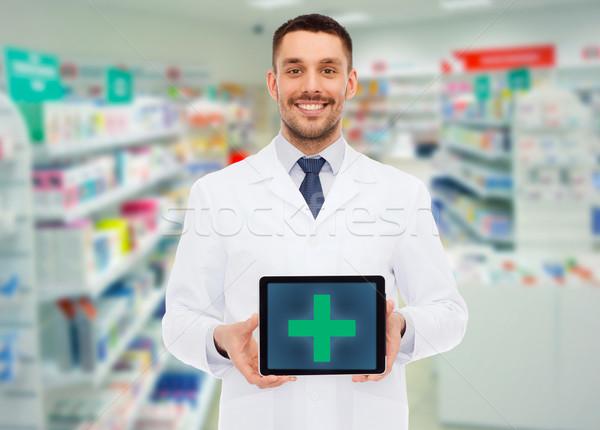 Glimlachend mannelijke arts drogist geneeskunde apotheek Stockfoto © dolgachov