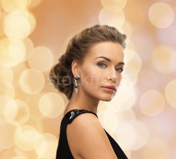 beautiful woman in evening dress wearing earrings Stock photo © dolgachov