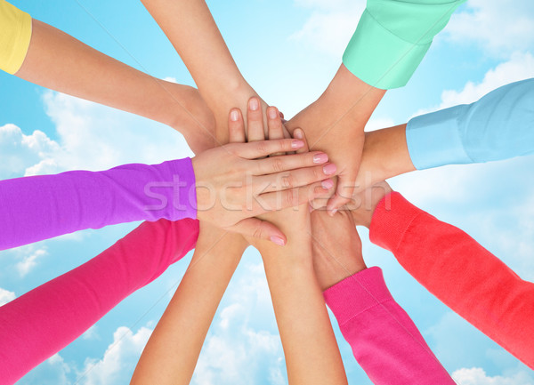 close up of women hands on top in rainbow clothes Stock photo © dolgachov