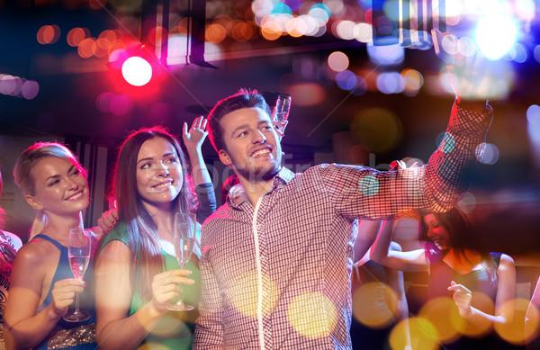 Amici smartphone night club party vacanze Foto d'archivio © dolgachov