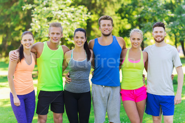 group of happy friends or sportsmen outdoors Stock photo © dolgachov