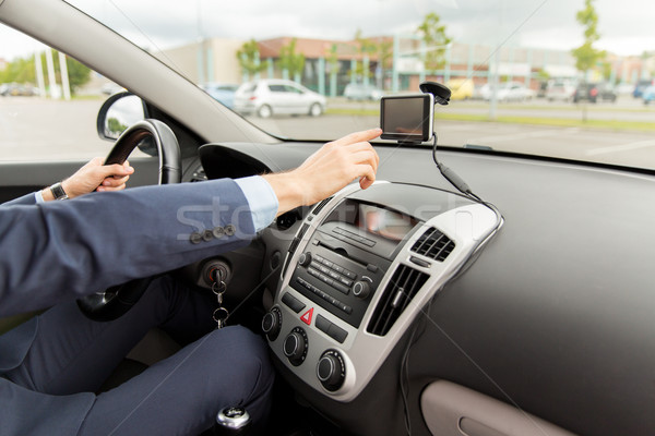 close up of man with gps navigator driving car Stock photo © dolgachov