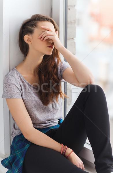 печально довольно сидят подоконник люди Сток-фото © dolgachov