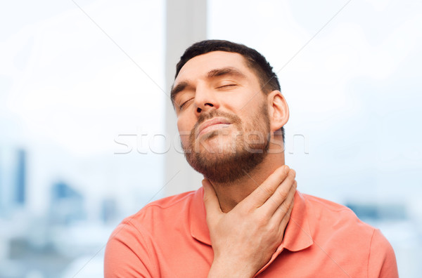 unhappy man suffering from throat pain at home Stock photo © dolgachov