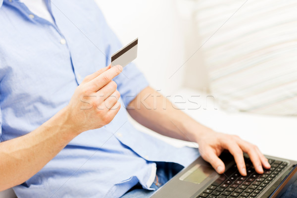 Stock photo: close up of man with laptop and credit card