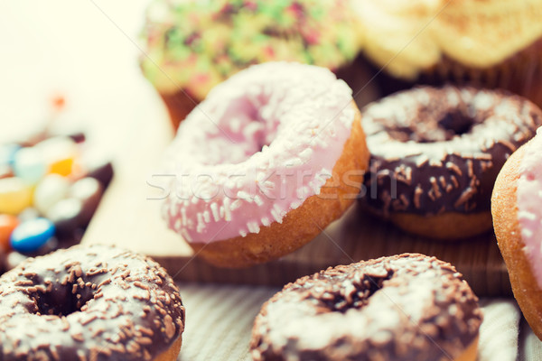 close up of glazed donuts pile on table Stock photo © dolgachov