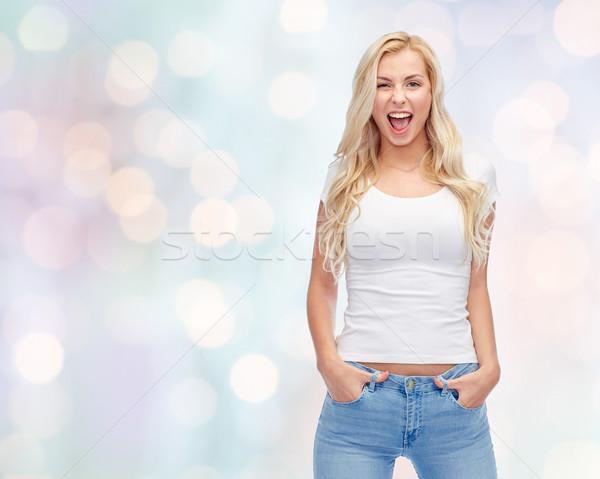 Heureux jeune femme adolescente blanche tshirt passions Photo stock © dolgachov