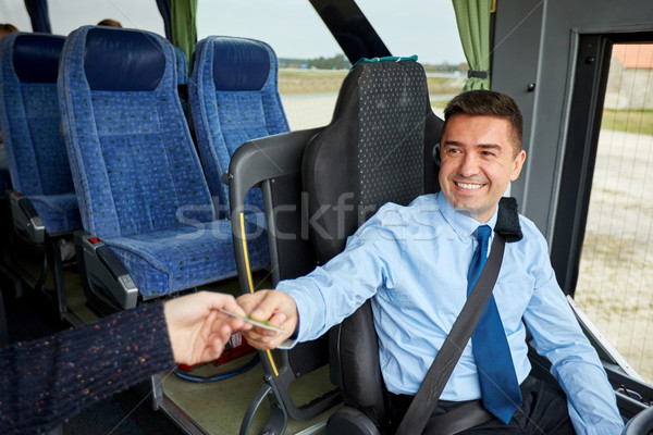 bus driver taking ticket or card from passenger Stock photo © dolgachov