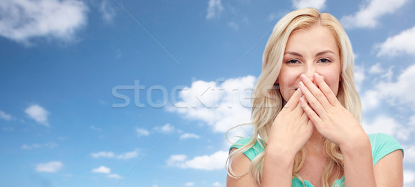young woman or teenage girl closing her nose Stock photo © dolgachov
