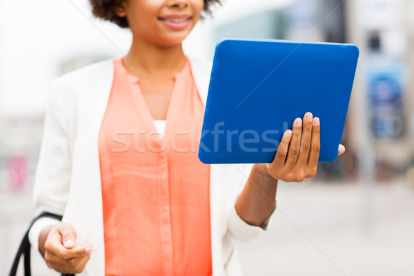 close up of african woman with tablet pc in city Stock photo © dolgachov