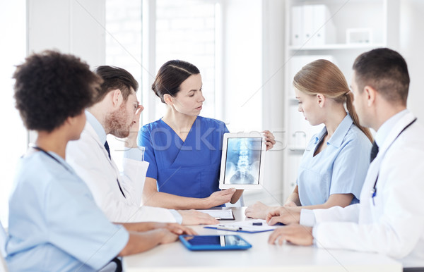 group of doctors with x-ray on tablet pc at clinic Stock photo © dolgachov