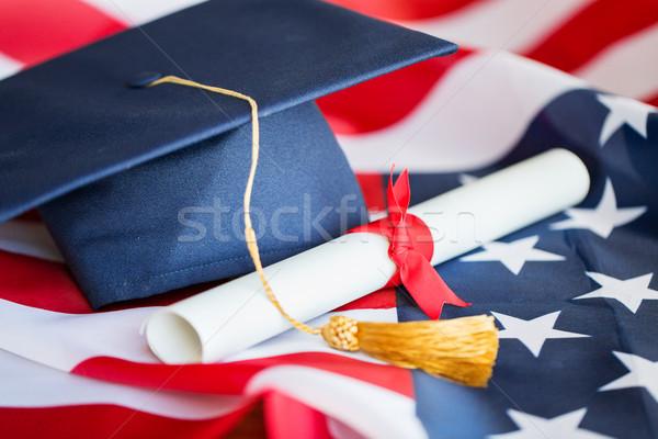 Stok fotoğraf: Bekâr · şapka · diploma · amerikan · bayrağı · eğitim · mezuniyet