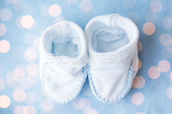 close up of baby bootees for newborn boy on blue Stock photo © dolgachov