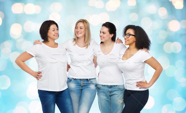 Groupe heureux différent femmes blanche amitié Photo stock © dolgachov