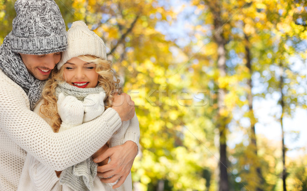 happy couple in warm clothes over autumn Stock photo © dolgachov