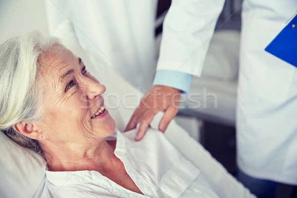 Lekarza szczęśliwy starszy kobieta szpitala muzyka Zdjęcia stock © dolgachov