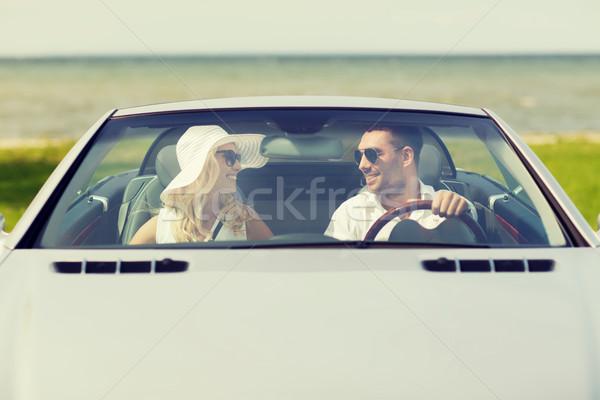 Feliz homem mulher condução cabriolé carro Foto stock © dolgachov