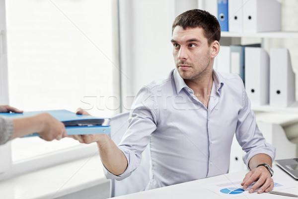 Empresário dobrador secretário escritório pessoas de negócios Foto stock © dolgachov
