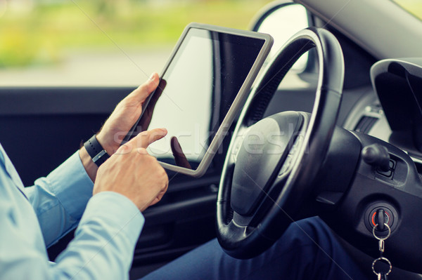 close up of young man with tablet pc driving car Stock photo © dolgachov