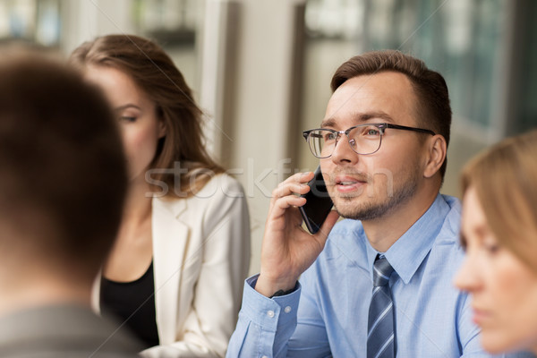 businessman calling on smartphone at office Stock photo © dolgachov
