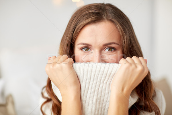 young woman or teen girl pulling pullover collar Stock photo © dolgachov