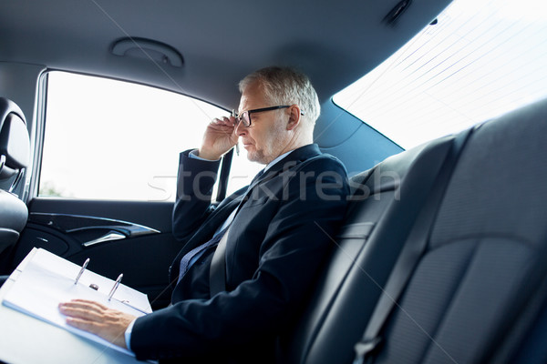 senior businessman with papers driving in car Stock photo © dolgachov