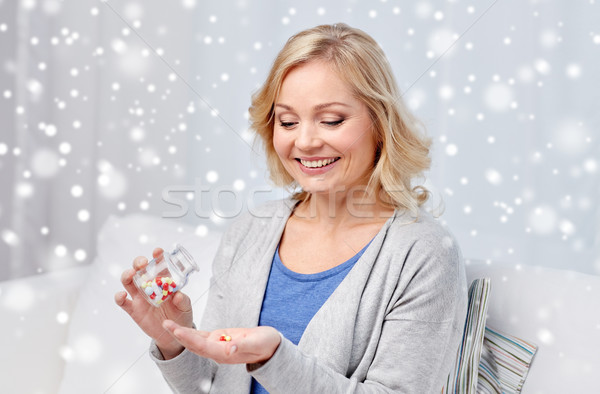 happy middle aged woman with medicine at home Stock photo © dolgachov