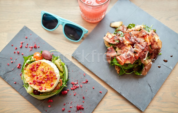 goat cheese and ham salads on cafe table Stock photo © dolgachov