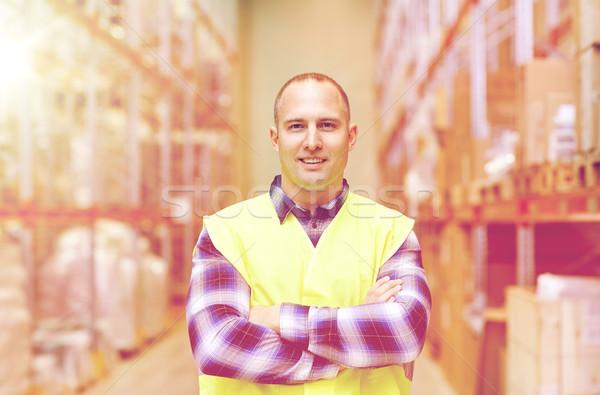 Heureux homme réfléchissant entrepôt Photo stock © dolgachov
