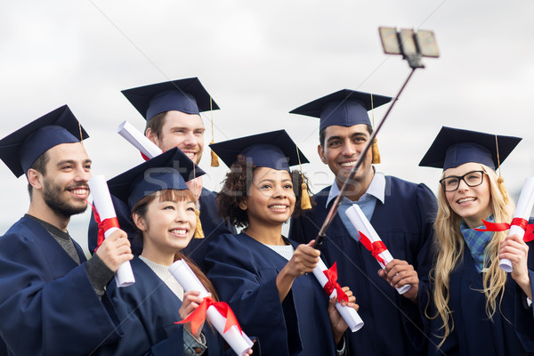 students or bachelors taking selfie by smartphone Stock photo © dolgachov