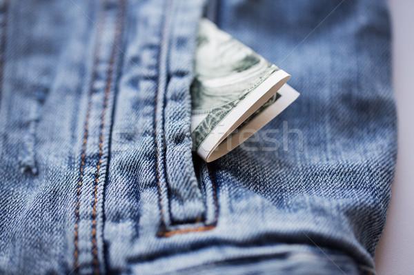 доллара деньги кармана джинсовой куртка Финансы Сток-фото © dolgachov